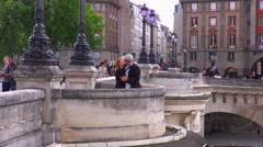 A man and woman kiss on a Paris bridge. Stock Footage