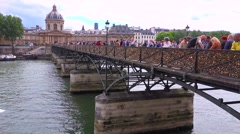 The Pont Des Artes bridge in paris features locks from couples expressing their - stock footage