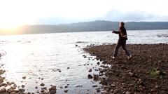 Man skimming stones - stock footage