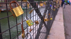 The Pont Des Artes bridge in paris features locks from couples expressing their Stock Footage