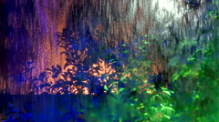 Rain in the window with multi colored lights Stock Footage