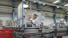 Workers on a production line in pharmaceutical and cosmetics factory - stock footage
