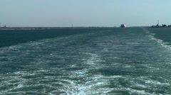 Egypt the Suez Canal 072 Port Said canal estuary with a stern wave - stock footage