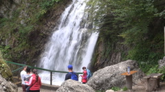 Mountain tourists. Hiking holiday. Group of hikers on vacation. Mountain trip. Stock Footage