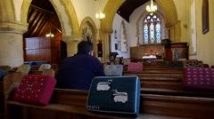 Man Prays in Church Stock Footage