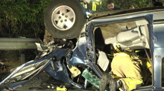 Overturned car night first responders at scene closeup Stock Footage