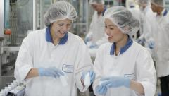 Workers on a production line in pharmaceutical and cosmetics factory Stock Footage