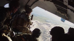 Special Ops in Open Doorway of Helicopter over Afghanistan Stock Footage