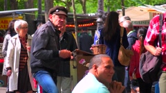 An street organ player entertains passersby in Paris, France. Stock Footage