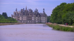 Long view down a canal to the beautiful chateau of Chambord in the Loire Valley Stock Footage