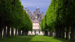 View between hedgerows to the beautiful chateau of Chambord in the Loire Valley Stock Footage