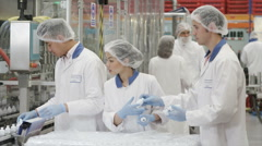 Asian workers on a production line in pharmaceutical and cosmetics factory Stock Footage