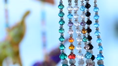 Detail jewelry hanging in hawker stall craft with indian elephants at backgro Stock Footage