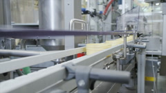Automated conveyor belt & robotic production Pharmaceutical & cosmetics industry Stock Footage