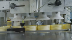 Stock Video Footage of Automated conveyor belt & robotic production Pharmaceutical & cosmetics industry