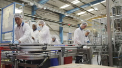 Stock Video Footage of Workers on a production line in pharmaceutical and cosmetics factory