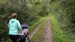 mother with baby buggy forest - stock footage