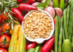 Raw organic yellow peas and vegetables Stock Photos