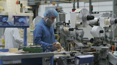 Workers & technicians operate machinery in factory. Drugs & cosmetics industry Stock Footage