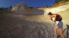 Woman hiking and climbing . Strong determined tourist woman is climbing the rock Stock Footage