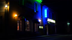 A small French hotel at night with neon sign flashing. Stock Footage