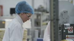 Workers & technicians operate machinery in factory. Drugs & cosmetics industry - stock footage
