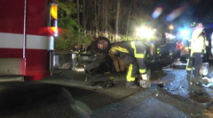 Overturned car night first responders setup wide shot Stock Footage