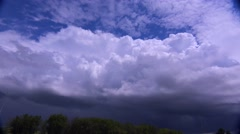 Large white thunderclouds loom on the horizon as a storm moves in. - stock footage