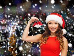 Stock Illustration of smiling woman in santa helper hat and jingle bells