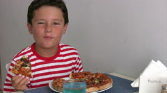 Child eating pizza - stock footage