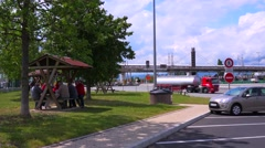French people have a picnic at a rest stop near a tollbooth. Stock Footage