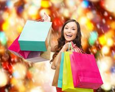 Stock Illustration of woman in red dress with colorful shopping bags
