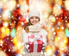 girl in hat, muffler and gloves with gift box - stock illustration