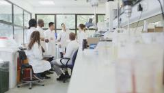 Young student scientists in group meeting at university college Stock Footage