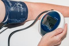 measuring blood-pressure - stock photo