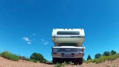 Small RV Camper Over Camera On Rural Dirt Road Stock Footage