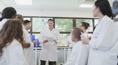Young student scientists in group meeting at university college - stock footage