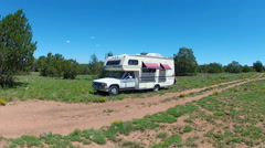 Small RV Camping Next To Dirt Road In Rural Setting Stock Footage