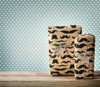 mustache pattered gift boxes with star shaped tags - stock photo