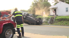 Overturned rolled over with tow truck winch Stock Footage