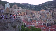 Spectators watch the Monaco Grand Prix from a high vantage point. Stock Footage