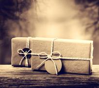 Handmade gift boxes in sepia tone Stock Photos