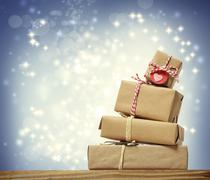 stack of handmade gift boxes over snowing night - stock illustration
