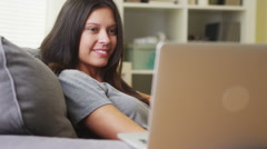 Young woman watching videos on laptop Stock Footage