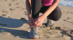 Fitness athletic girl lacing sport shoes before start jogging Stock Footage