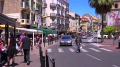 Classic street view of a pretty boulevard in Cannes, France. - stock footage