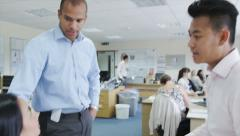 Office staff in business meeting in modern office Stock Footage
