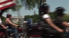 Motorcycles pass by white house - stock footage