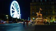 Statues of Jeanne D'arc with Ferris Wheel in Paris,time lapse,4k Stock Footage