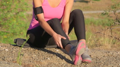 Workout fitness injuries young woman with pain in the leg - stock footage
